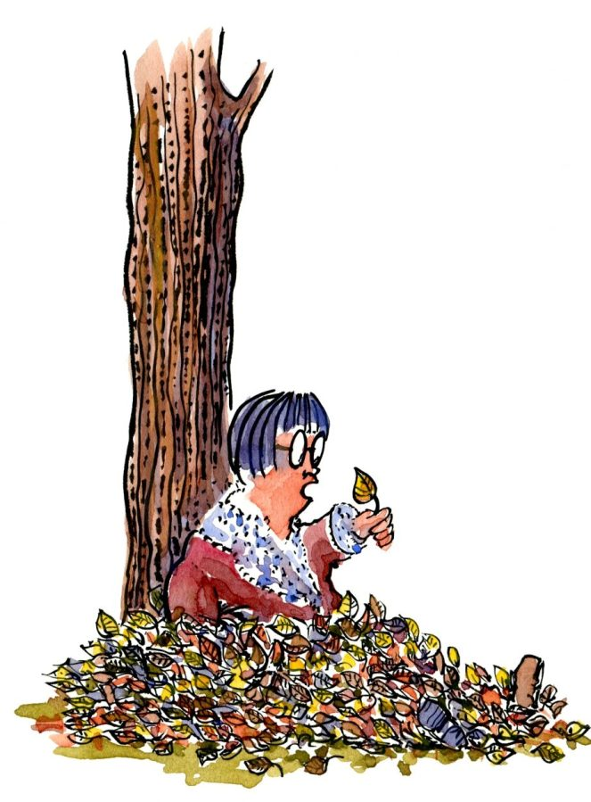 woman sitting in the leaves talking with them