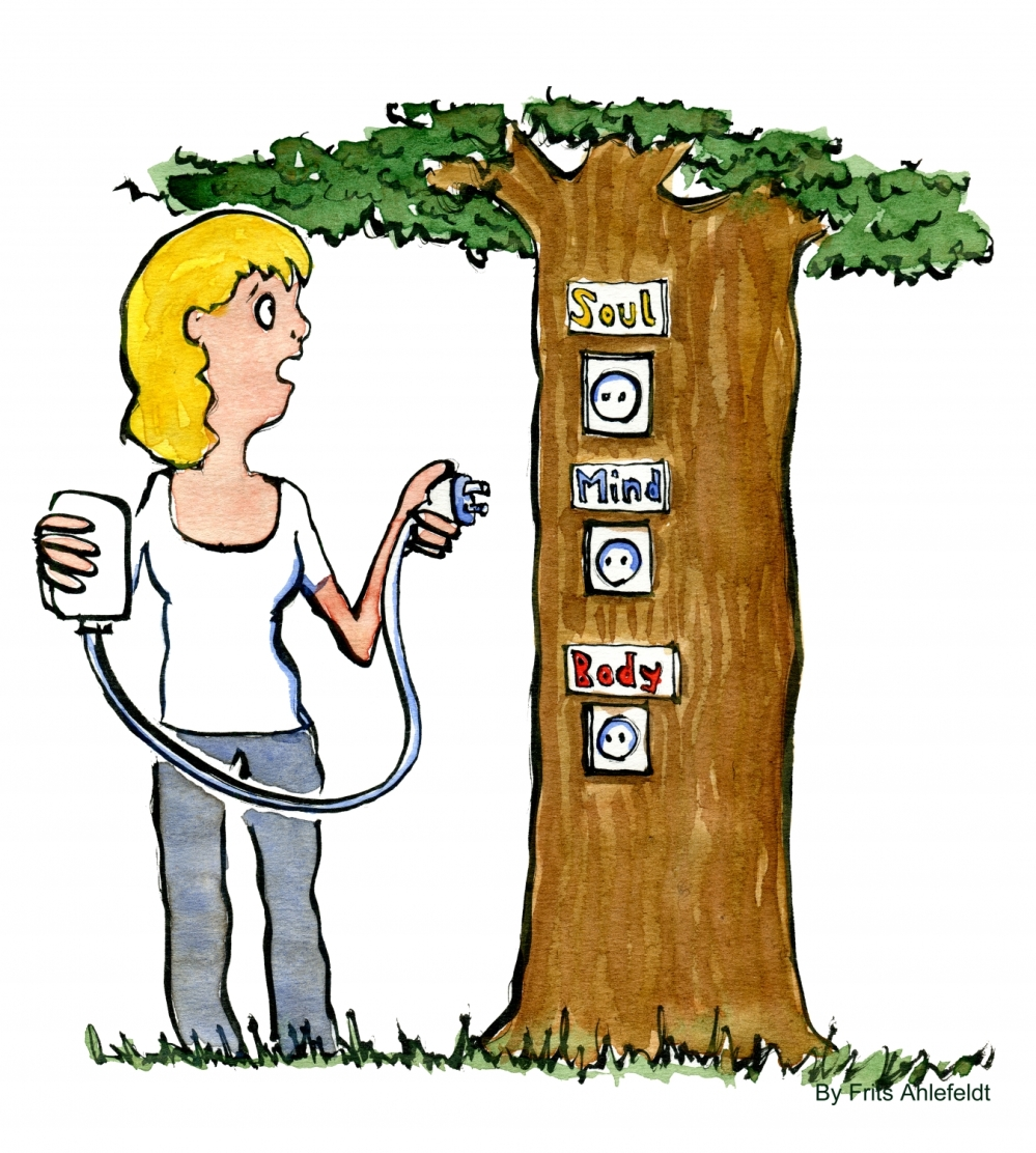 woman plugging her smartphone into a tree