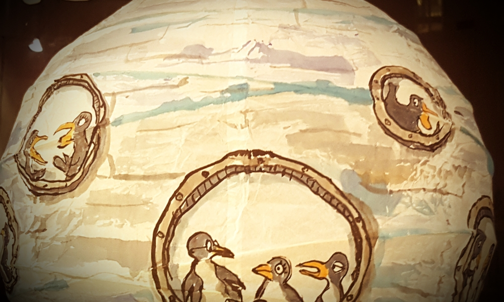 sphere, rice paper lamp painting of a penguin submarine. Artwork by Frits Ahlefeldt