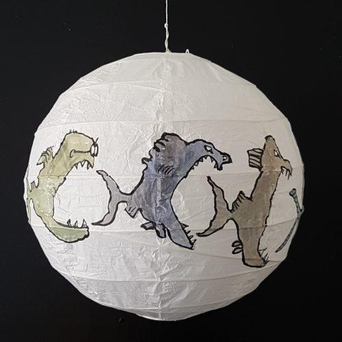 Drawing of fish eats fish eats fish on rice paper lamp. Artwork by Frits Ahlefeldt